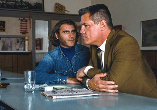 "Joaquin Phoenix stars as Doc Sportello and Josh Brolin stars as Detective Christian F. ""Bigfoot"" Bjornsen in ""Inherent Vice,"" a 2014 Warner Brothers release adapted from Thomas Pynchon's novel and directed by Paul Thomas Anderson."