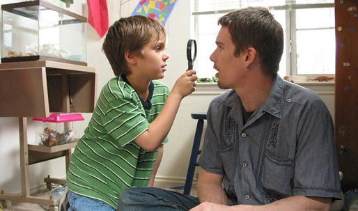 "Ellar Coltrane and Ethan Hawke star in ""Boyhood."""