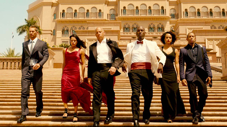 "From left, Paul Walker, Michelle Rodriguez, Vin Diesel, Tyrese Gibson, Nathalie Emmanuel and Chris ""Ludacris"" Bridges star in ""Furious Seven,"" a 2015 Universal Pictures release directed by James Wan."