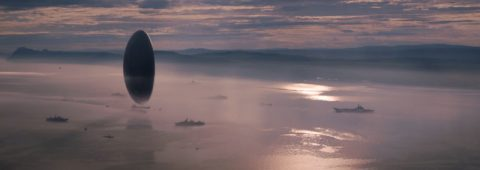 "An alien craft hovers above the water in ""Arrival,"" a 2016 Paramount Pictures release directed by Denis Villeneuve."
