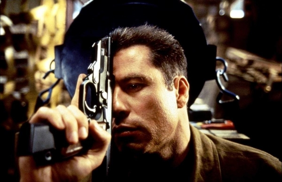 "John Travolta goes the ""Head On. Apply directly to forehead"" route in ""Broken Arrow,"" John Woo's 1996 action-thriller distributed by 20th Century Fox."