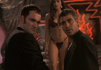 "Richie Gecko (Quentin Tarantino) and Seth Gecko (George Clooney) look on in disbelief as Santanico Pandemonium (Salma Hayek) holds court in 1996's ""From Dusk Till Dawn,"" a Dimension Films release."
