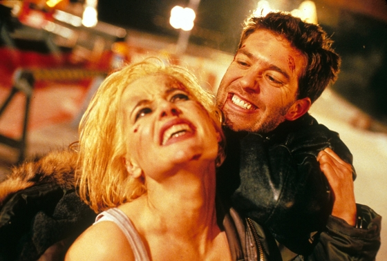 """Charly Baltimore (Geena Davis) is under the thumb of the villainous Timothy (Craig Bierko), but not for long in """"The Long Kiss Goodnight,"""" Renny Harlin's 1996 action-thriller for New Line Cinema."""