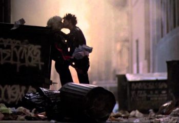 "Nancy Spungen (Chloe Webb) and Sid Vicious (Gary Oldman) kiss among the garbage in Alex Cox's 1986 film ""Sid and Nancy."""