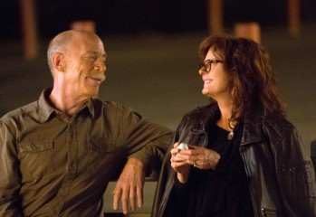"This image released by Sony Pictures Classics shows J.K. Simmons, left, and Susan Sarandon in a scene from ""The Meddler."" (Jaimie Trueblood/Sony Pictures Classics via AP)"