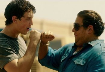 "Gunrunners David Packouz (Miles Teller) and Efraim Diveroli (Jonah Hill) fist-bump after delivering some Berettas to Iraq in ""War Dogs,"" a 2016 comedy-drama from Warner Brothers."