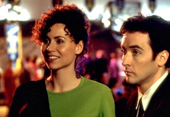"Debi Newberry (Minnie Driver) and Martin Blank (John Cusack) try to make it out of their 10-year class reunion alive in ""Grosse Pointe Blank,"" a 1997 comedy from Hollywood Pictures."