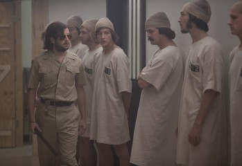 """The Stanford Prison Experiment,"" based on a true story, stars Michael Angarano and Ezra Miller."
